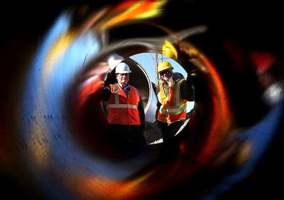 John Collins and Tara Bevard discuss new sewer line along Capital Avenue.